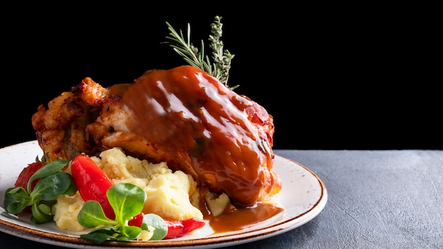 Roasted pork knuckle with mashed potatoes.