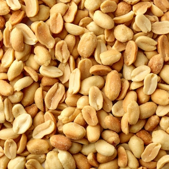 Roasted salted peanut background, top view