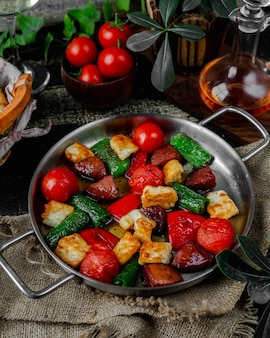 Roasted sausage and vegetables in pan