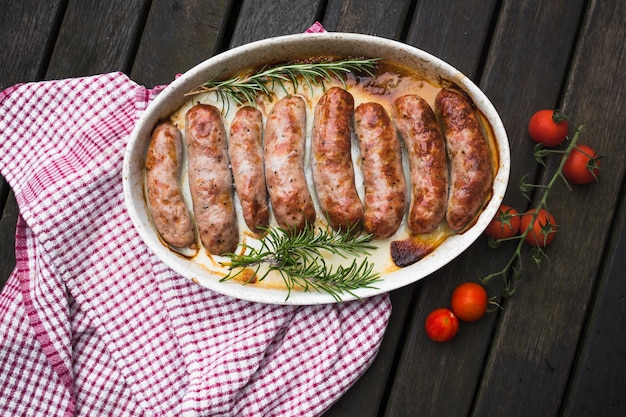 Roasted sausageson plate with potherbs