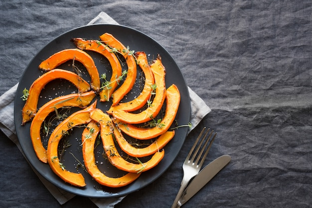 Roasted sliced pumpkin with thyme and salt.