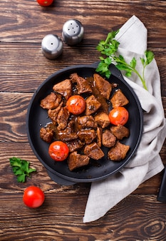 Roasted or stewed beef meat with tomato