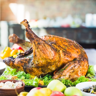 Roasted turkey with food on table