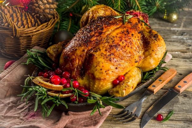 Roasted whole chicken with christmas decoration