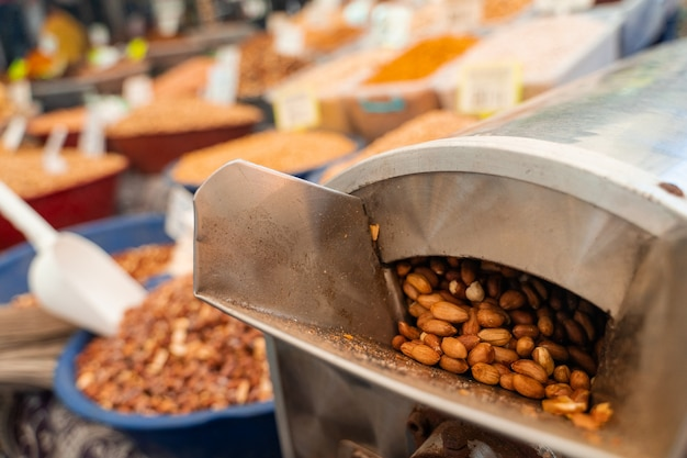 Roasting and blanching peanuts. process of peeling peanuts in machine.