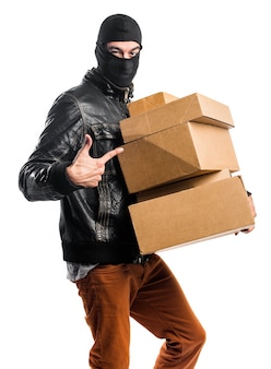 Robber holding boxes