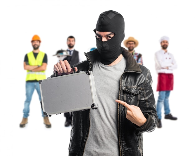 Robber holding a briefcase