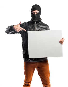 Robber holding an empty placard