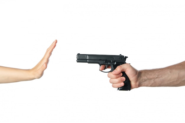 The robber pointed a hand with a gun at a woman, isolated on white
