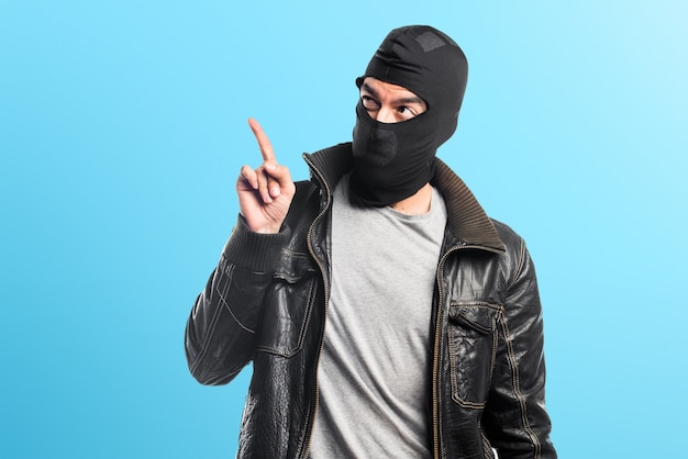 Robber pointing up on colorful background