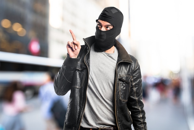 Robber pointing up on unfocused background