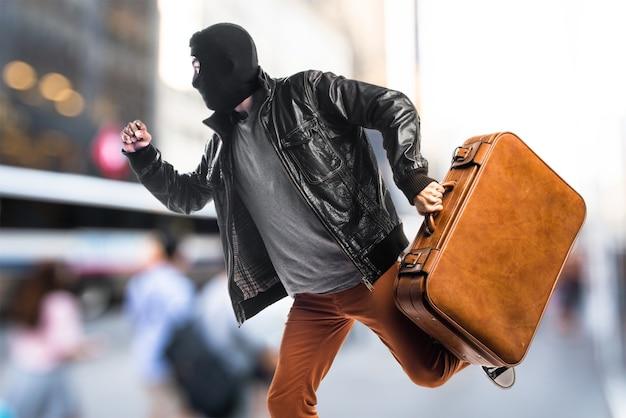 Robber running fast on unfocused background