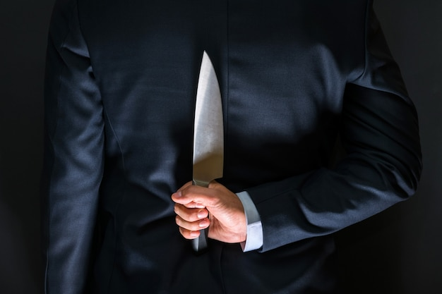Robber with big knife - a killer person with sharp knife about to commit a homicide.