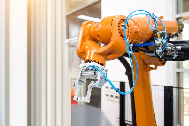 Robot arm automation handling system for industrial manufacturing.