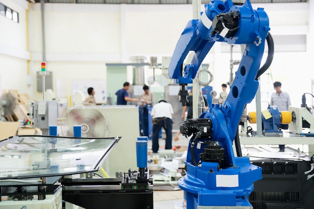 The robot glass sealing wind shield in the assembly manufacturing factory.