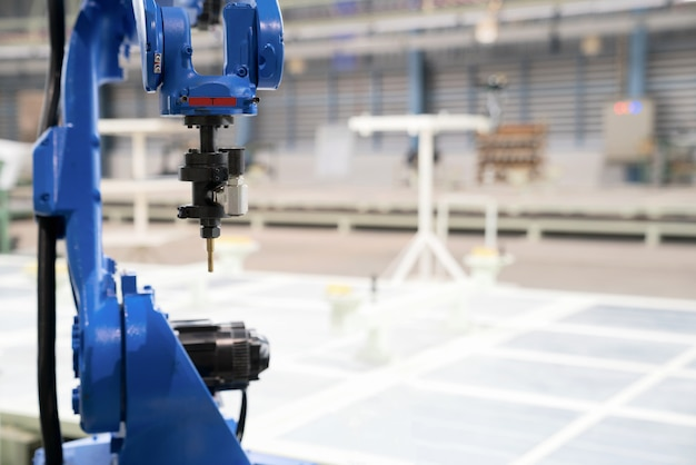 The robot glass sealing wind shield in the car manufacturing.