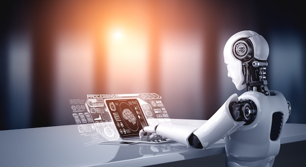 Robot humanoid use laptop and sit at table for big data analytic
