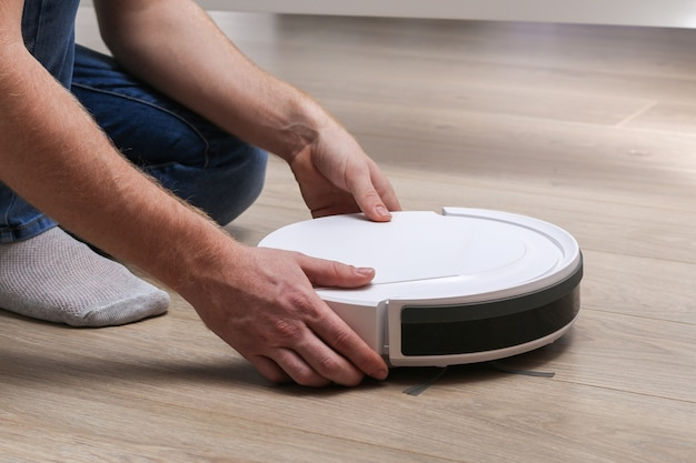 Robot vacuum cleaner cleans under the bed.