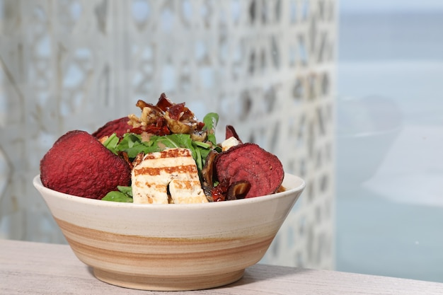 Rocca salad plate lebaneese food appetizer and dressing with halloumi cheese