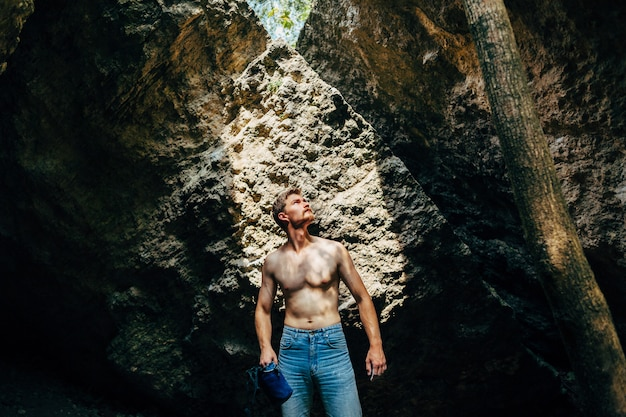 Rock climber standing with powder chalk magnesium in his hands
