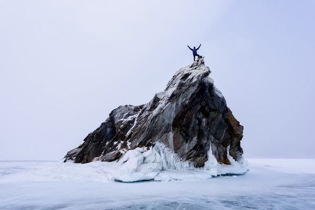 Rock climber on the top of mountain island. sport and active life