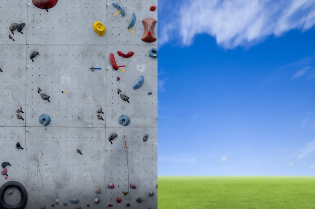 Rock climbing on an artificial wall with blue sky background
