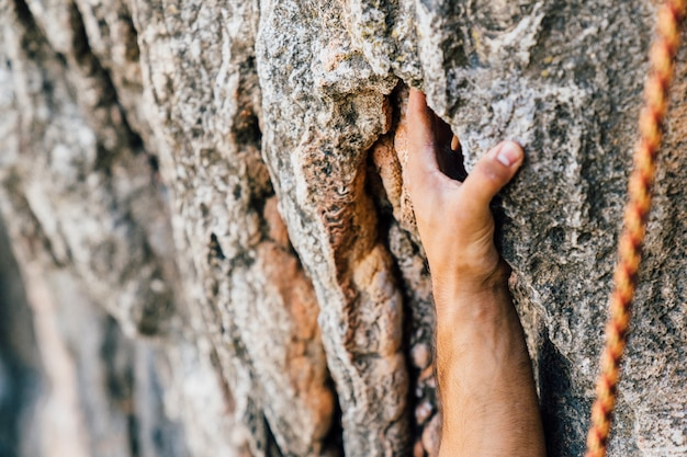 Rock climbing concept with hand
