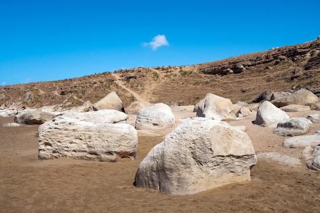 Rock fragments on the ocean shore