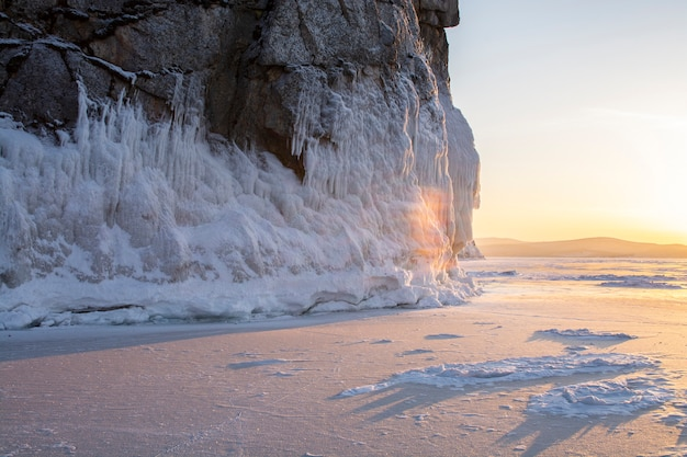 Rock island at twilight in lake baikal, russia, landscape