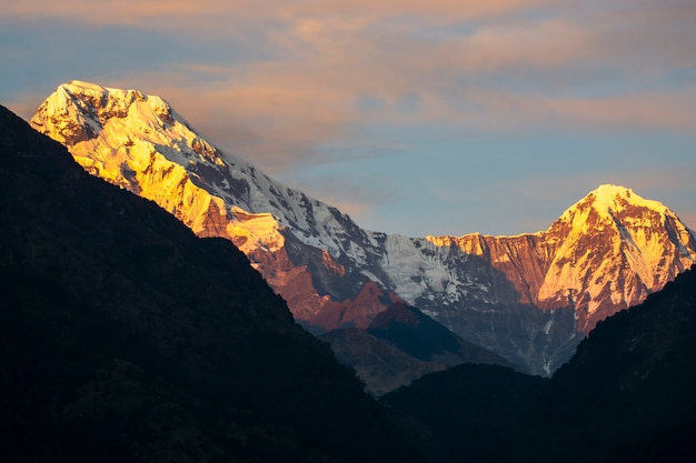 Rock mountain peaks in annapurna mountain range with light of sunrise, nepal