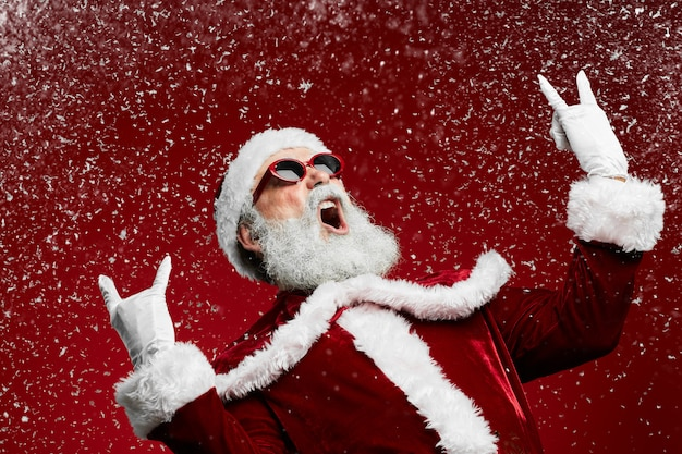 Rock santa claus on red
