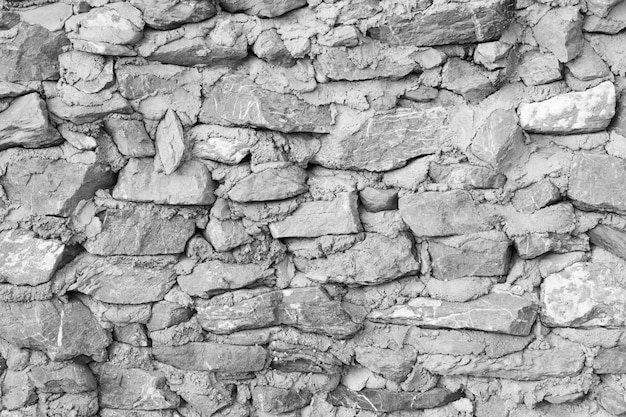 Rock stone wall texture grunge background with vignetted corners