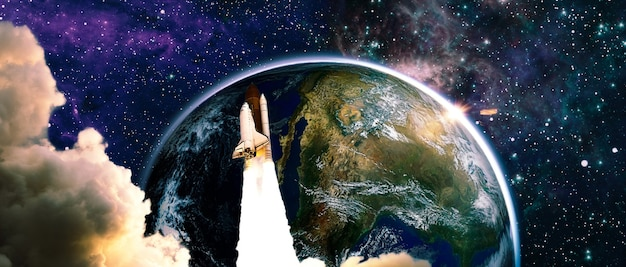 Rocket in space, earth in distance.space shuttle orbiting earth planet. the elements of this image furnished by nasa.