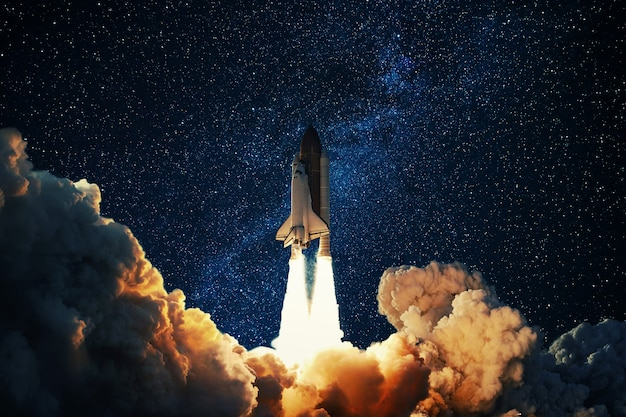 Rocket takes off in the starry sky