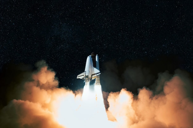 Rocket with clouds of smoke takes off upward into space. spaceship completes mission and launches into space