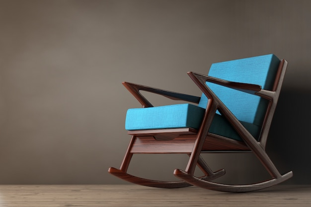 Кресло-качалка, обитое синей тканью, на деревянном полу. 3d рендеринг