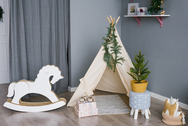 Rocking horse in a children room decorated for christmas