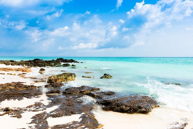 Rocks on the beach in tropical sea at bamboo island krabi province