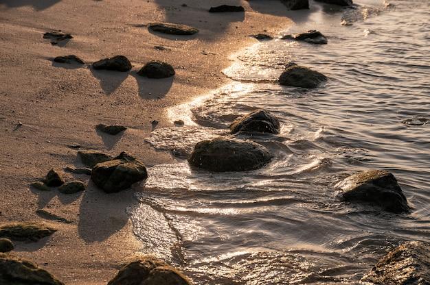 Rocks on coastline at sunset