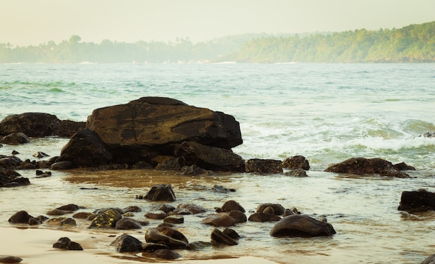 Rocks in an ocean bay with waves
