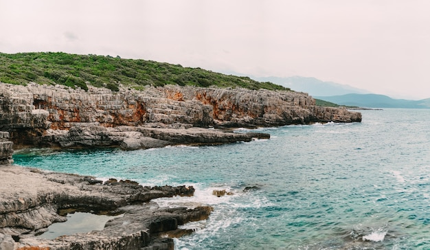 Rocks on the sea in montenegro rocky coast wild beach