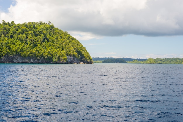 Rocky coastline of island spotted by islets