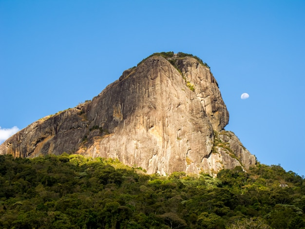 Rocky mountain in brazil and full moon - pedra do bau