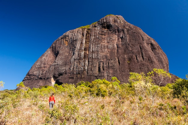 Rocky mountain trekking with people in brazil - pico do papagaio