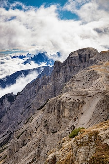 Rocky mountains in italy with cloudy sky, dolomites, tre cime di lavaredo