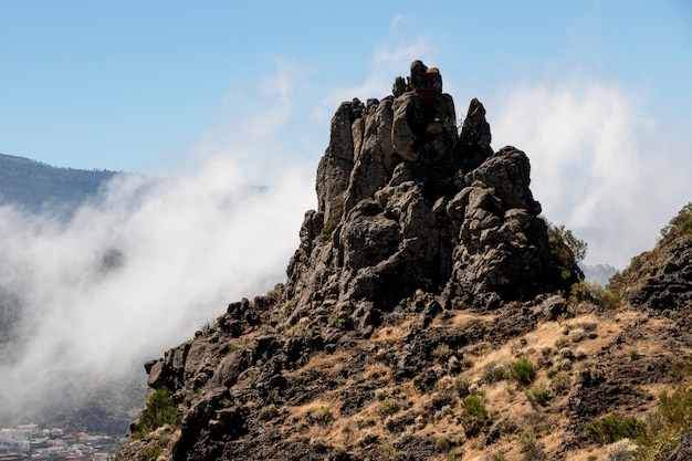 Rocky peak surrounded by clouds