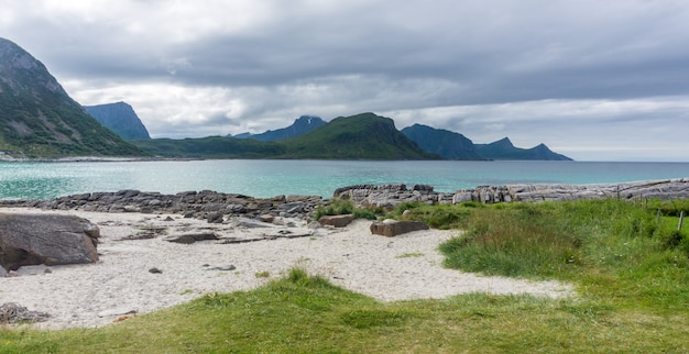 Rocky shore, sandy beach with turquoise water, lofoten archipelago, norway