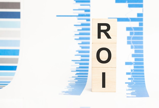 Roi sign on wooden cubes concept, wooden cubes.