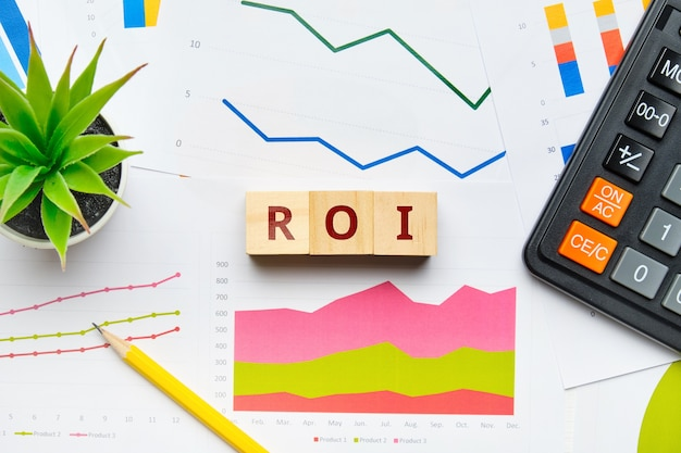 Roi with graphs and reports on paper.