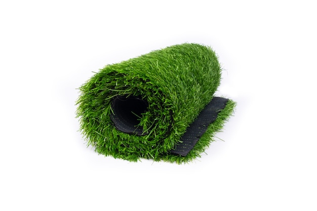 Roll of artificial grass isolated on white wall.